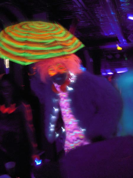 And hundreds of people in black light reactive costumery