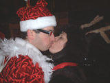 Santa smooches1 - NYC SantaCon, 2002